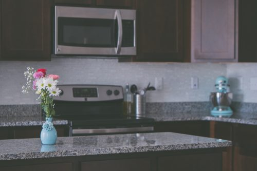 Granite Countertops - Kitchen With Flowers